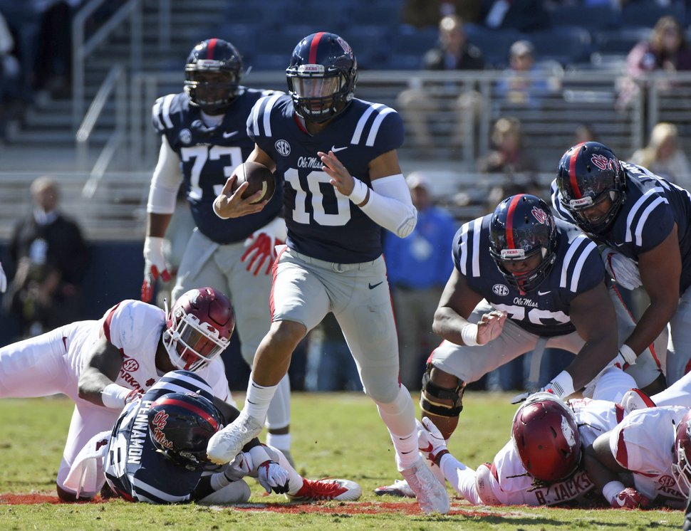 File- This Oct. 28, 2017, file photo shows Mississippi quarterback Jordan Ta'amu (10) carrying the ball for a 49-yard touchdown run during the first half of an NCAA college football game against Arkansas in Oxford, Miss. Ta'amu has emerged as the starter at Mississippi after filling in for the injured Shea Patterson last season. Ta'amu completed nearly 67 percent of his passes for 1,682 yards and 11 touchdowns and earned the full-time job in the offseason after Patterson decided to transfer to Michigan. (AP Photo/Thomas Graning, File)