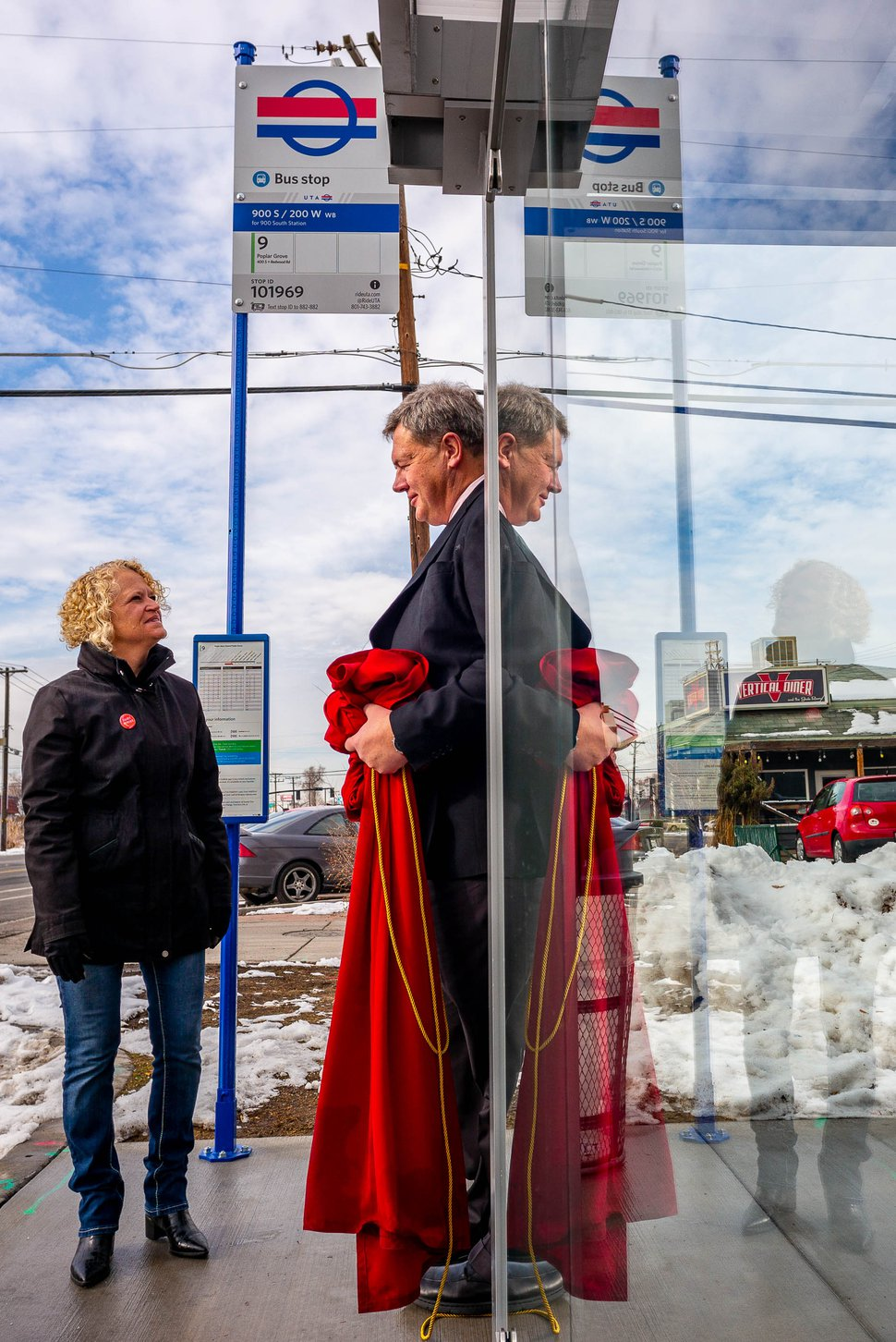 (Trent Nelson | The Salt Lake Tribune) Salt Lake City Mayor Jackie Biskupski and UTA's Carlton Christensen unveil a new sign intended to make bus stops more identifiable at a news conference in Salt Lake City on Monday Dec. 2, 2019.