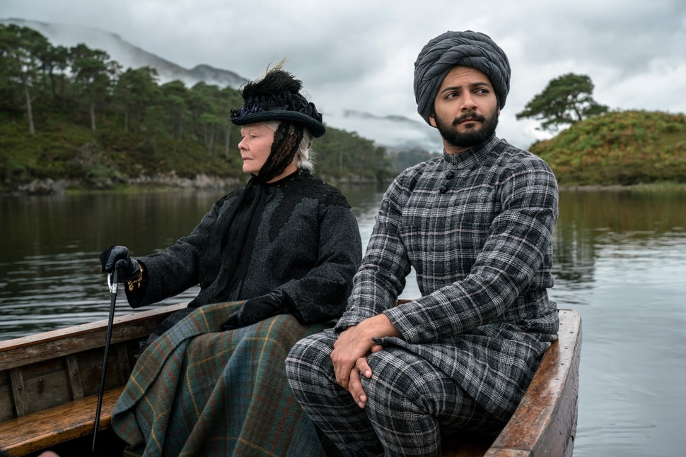 (Peter Mountain | courtesy Focus Features) Queen Victoria (Judi Dench, left) and Abdul Karim (Ali Fazal), an Indian Muslim who became her confidant in her final years, ride in a boat to her Scottish castle Balmoral, in director Stephen Frears'