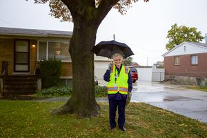 (Saige Miller | The Salt Lake Tribune) My Hometown block captain and long time West Valley City resident Bonnie Shaw attends the day of service on Saturday, Oct. 9, 2021 with a clipboard in hand and a name badge that makes her Òfeel like superwoman.Ó