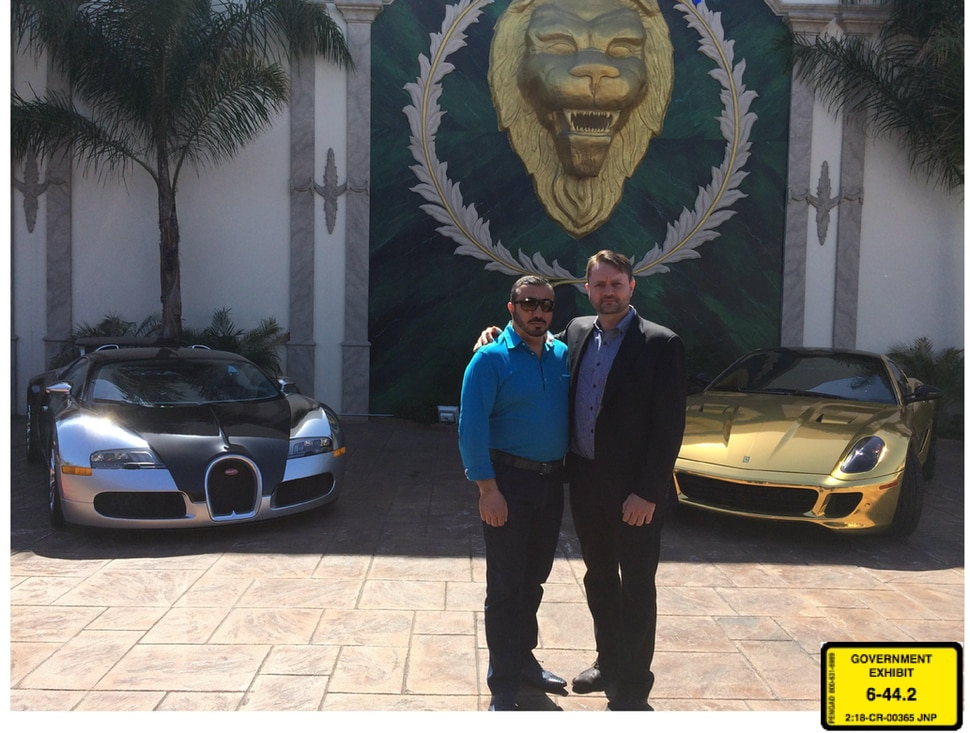 (Courtesy U.S. District Court for the District of Utah) Lev Dermen, left, stands with Jacob Kingston at a banquet hall in Southern California in 2014. Federal prosecutors say this photo is evidence of how Kingston purchased the 2010 Bugatti Veyron, left, for $1.72 million to give Dermen, and Dermen purchased the Ferrari, right to give to Kingston to launder money from a biofuel fraud. Kingston has pleaded guilty to crimes. Dermen has pleaded not guilty. Behind the men is a sculpture of a lion's head, the animal Dermen associates himself with.