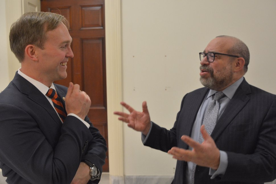 (Peter Urban | Special to The Tribune) Rep. Ben McAdams listens to trade lobbyist Claude G. B. Fontheim in the hallway outside his Cannon Building office.