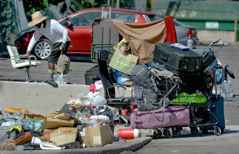 (Francisco Kjolseth | The Salt Lake Tribune) Homeless individuals camp out on the streets of downtown Salt Lake City on Wednesday, Aug. 12, 2020. Racial minorities are more likely to face homelessness in Salt Lake County than white people are, a new analysis of homeless system data shows.