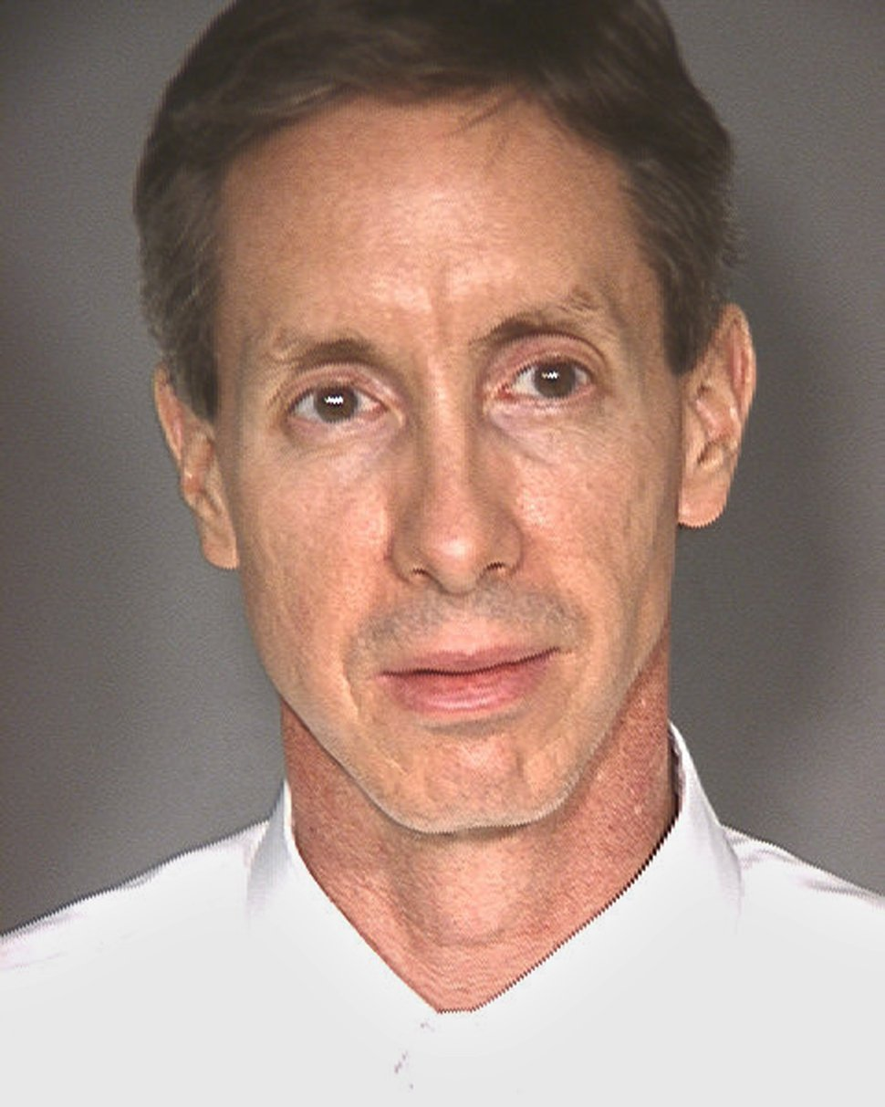 This image provided by the Las Vegas Metropolitan Police Department shows a booking photograph of Warren Jeffs after his arrest late Monday. Jeffs, who was on the FBI's Most Wanted List was found with cell phones, laptop computers, wigs and more than $50,000 in cash when he was arrested in Nevada, authorities said Tuesday Aug. 29, 2006.(AP Photo/Las Vegas Metropolitan Police Department)