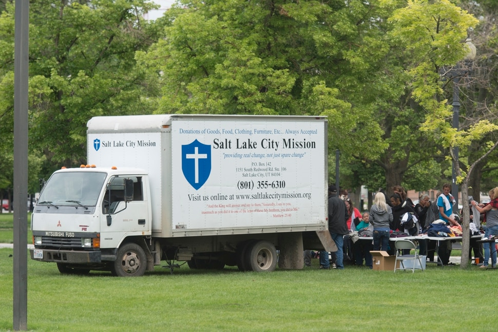 (Rick Egan | The Salt Lake Tribune) The Salt Lake City Mission distributes clothes to the homeless in Pioneer Park on Memorial day, Monday, May 28, 2018.