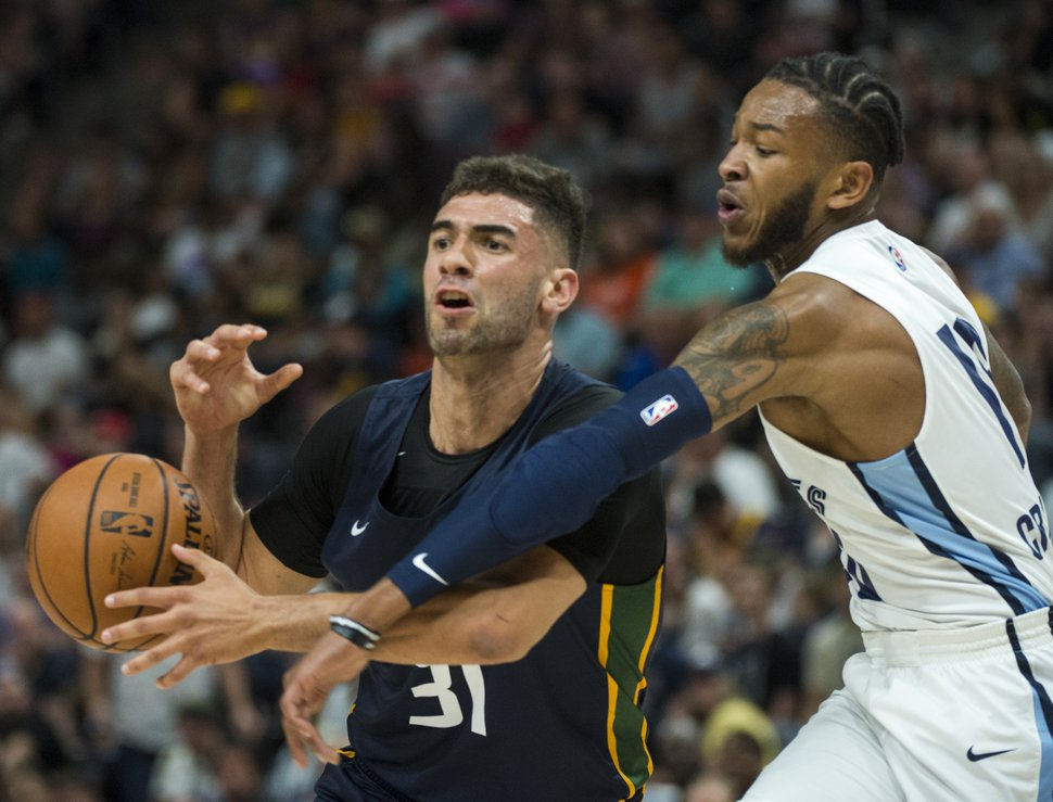 (Rick Egan | The Salt Lake Tribune) Memphis Grizzlies Markel Crawford. knocks the ball out of the hands of Utah Jazz forward Georges Niang (31), in Utah Jazz summer league action between Utah Jazz and Memphis Grizzlies in Salt Lake City, Tuesday, July 3, 2018.