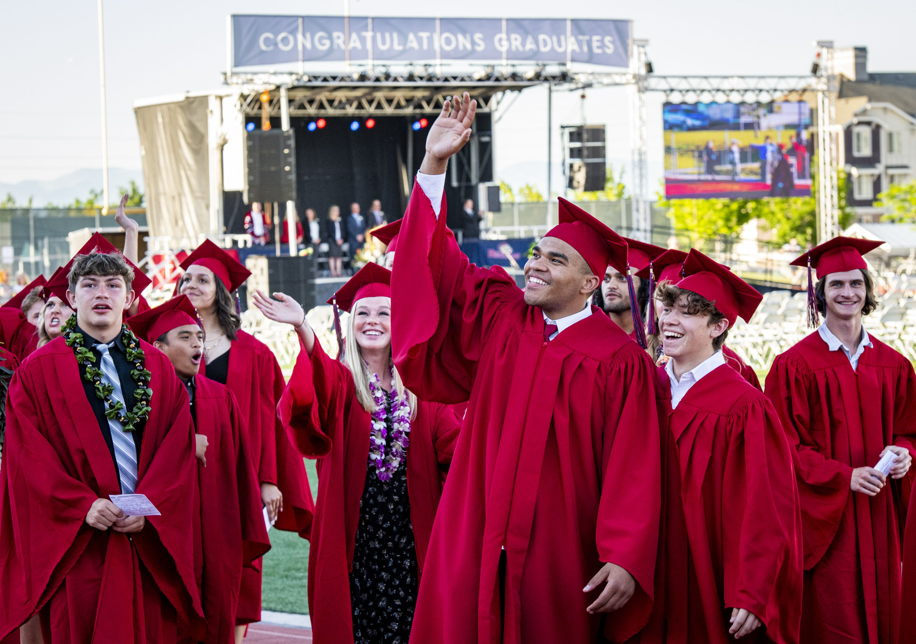 (Isaac Hale | Special to The Tribune) Graduates wave to family and friends while they process onto the field during Herriman High School's graduation ceremony held Thursday, June 3, 2021.