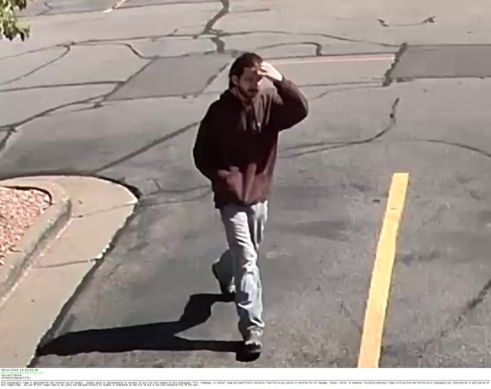 (Photo courtesy of Unified Police department) Surveillance images show a man accused of robbing a Key Bank in Millcreek on Thursday, Sept. 12, 2019. Police are seeking help from the public to find the man.