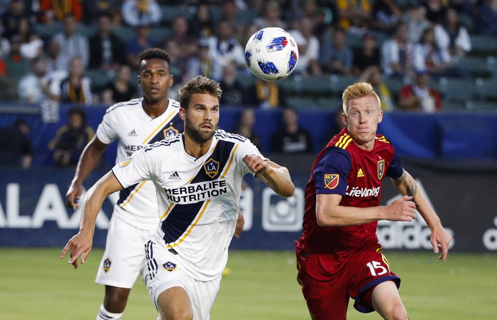 Los Angeles Galaxy's Jorgen Skjelvik, left, and Real Salt Lake's Justen Glad go after the ball during the first half of an MLS soccer match Saturday, June 9, 2018, in Carson, Calif. (AP Photo/Jae C. Hong)