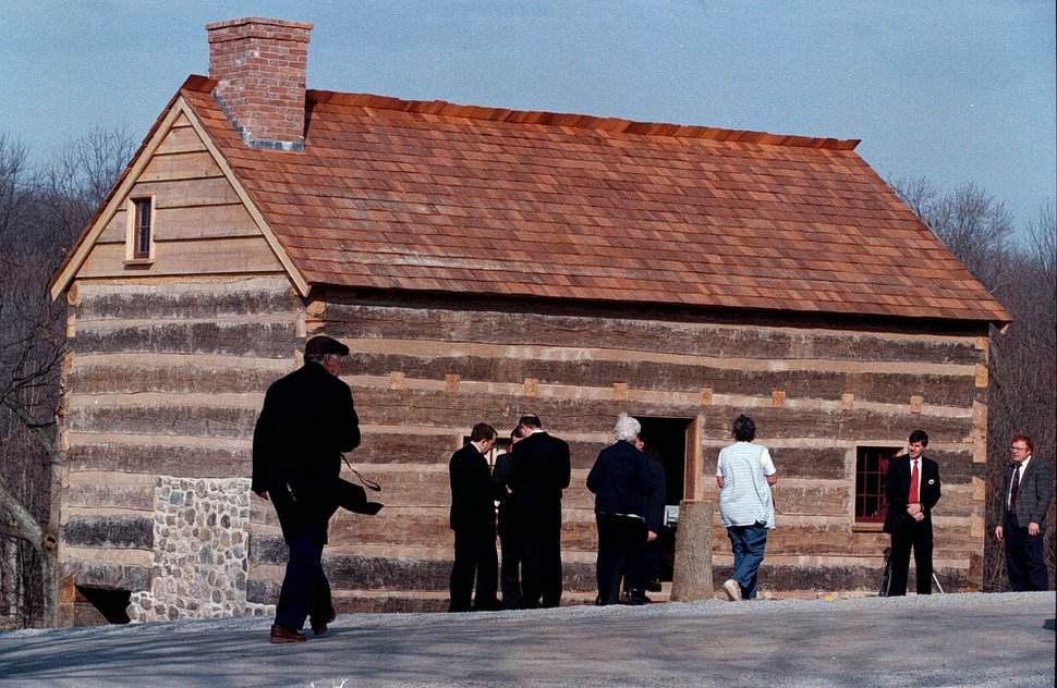 (Wayne Scarberry | AP file photo) Visitors gather in 1998 in Palmyra, N.Y., where then-LDS leader Gordon B. Hinckley dedicated a replica of the log house where Joseph Smith lived. Church historic sites underwent changes during Steve Snow's time as church historian.