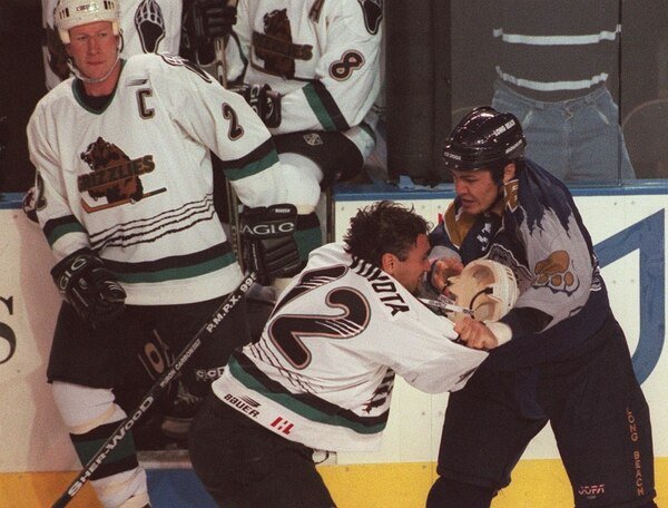 Leah Hogsten   The Salt Lake Tribune The gloves and helmets came off during the first period and the fists began flying between Utah Grizzlies Mick Vukota and Long Beach Ice Dogs Jason Shmyr during Saturday Oct 10, 1998 game at the E Center.