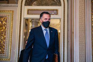 (Brandon Bell | The New York Times) Sen. Mitt Romney walks through the Senate Reception Room at the Capitol in Washington on Wednesday, Feb. 10, 2021.