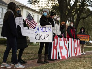 "(Marie D. De Jesús | Houston Chronicle via AP)  In this Feb. 18 photo, demonstrators stand in front of U.S. Sen. Ted Cruz's home demanding his resignation in Houston. Cruz has acknowledged that his family vacation to Mexico was ""obviously a mistake"" as he returned stateside following an uproar over his disappearance during a deadly winter storm."