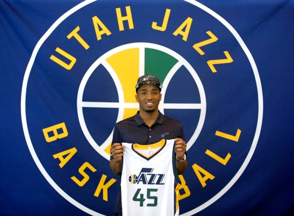 Utah Jazz's Donovan Mitchell poses for photos after the Jazz introduced their 2017 NBA Draft picks during a news conference Wednesday, June 28, 2017, in Salt Lake City. (AP Photo/Rick Bowmer)