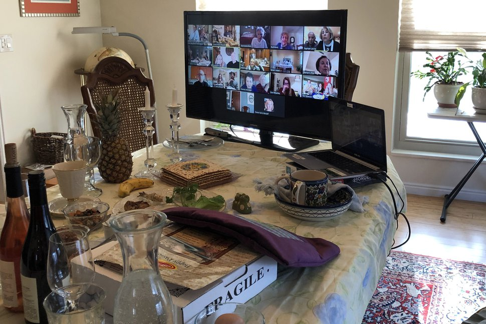 (photo courtesy Diane Hartz Warsoff) Participants in a virtual Seder are seen on screen at the home of Art and Diane Hartz Warsoff on April 8, 2020.