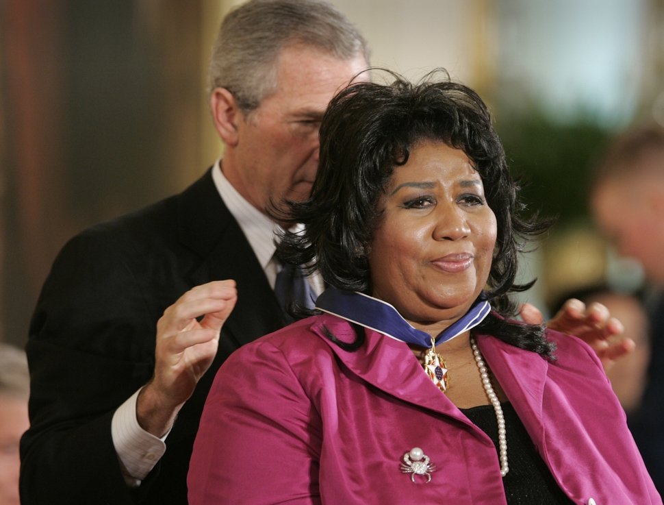FILE - In this Nov. 9, 2005 file photo, President George W. Bush awards singer Aretha Franklin the Presidential Medal of Freedom Award, the highest civilian award, in the East Room of the White House in Washington. A person close to Franklin said on Monday that the 76-year-old singer is ill. Franklin canceled planned concerts earlier this year after she was ordered by her doctor to stay off the road and rest up. (AP Photo/Lawrence Jackson, File)