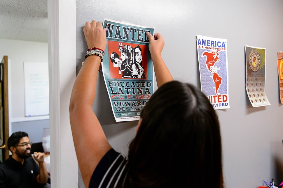 (Trent Nelson | The Salt Lake Tribune) Brianda Galeana puts up posters at the University of Utah's new Dream Center, Friday August 18, 2017.