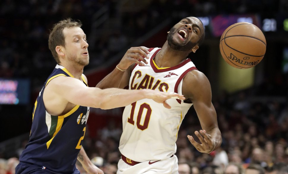 Utah Jazz's Joe Ingles (2), from Australia, knocks the ball loose from Cleveland Cavaliers' Alec Burks (10) in the first half of an NBA basketball game, Friday, Jan. 4, 2019, in Cleveland. (AP Photo/Tony Dejak)