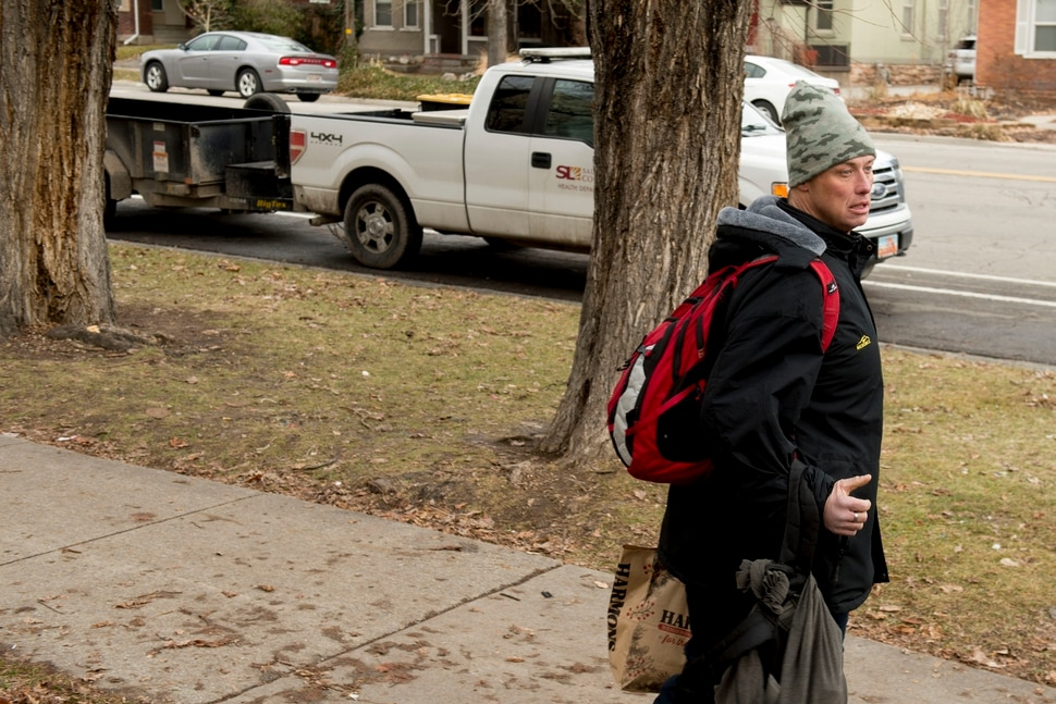 (Jeremy Harmon | The Salt Lake Tribune) Jaron Taylor leaves Taufer Park near downtown Salt Lake City as the health department arrives to clean up the area on Thursday, January 9, 2020. A new outreach group called Addict to Advocate was at the park helping people gather their belongings in advance of the health department's arrival.