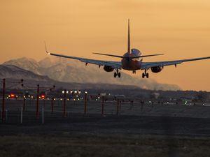 Leah Hogsten  |  The Salt Lake Tribune   A plane lands at Salt Lake City International Airport, Feb. 25, 2019.