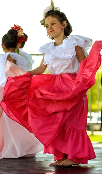 (Leah Hogsten | The Salt Lake Tribune) Tuttilli Ballet Folklorico dancer Victoria Judd, 6, performs at the Cinco de Mayo Celebration, Saturday, May 5, 2018 at Centennial Park in West Valley City.