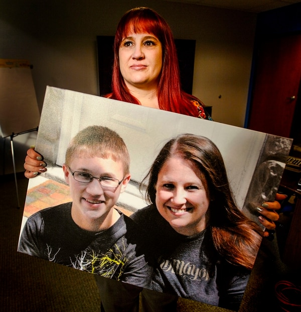 (Steve Griffin | The Salt Lake Tribune) Shari Elliott holds a photo of herself with her son, Avery Kertamus, in her office in South Jordan. The 15-year-old died by suicide in 2013.