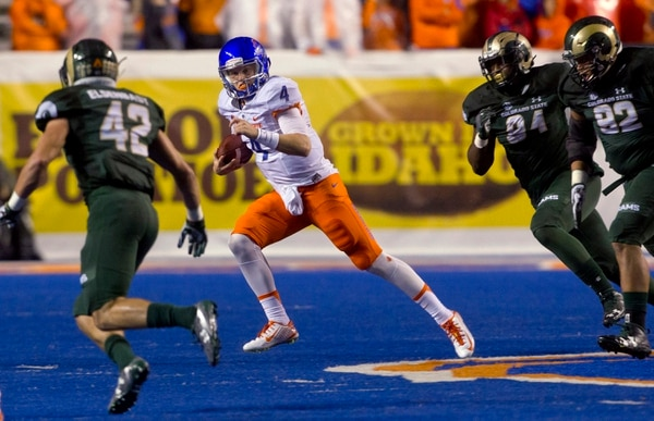 Boise State quarterback Brett Rypien (4) keeps the ball and runs against the Colorado State defense during the first half of an NCAA college football game Saturday Oct. 15, 2016, in Boise, Idaho. (Darin Oswald/Idaho Statesman via AP)