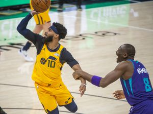(Rick Egan | The Salt Lake Tribune) Utah Jazz guard Mike Conley (10) shoots as Charlotte Hornets center Bismack Biyombo (8) defends, in NBA action between the Utah Jazz and the Charlotte Hornets at Vivint Arena, on Monday, Feb. 22, 2021.