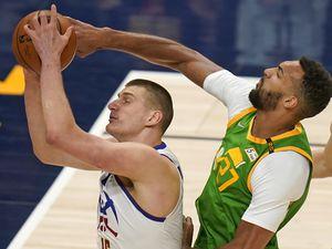 Utah Jazz center Rudy Gobert, right, defends against Denver Nuggets center Nikola Jokic during the first half of an NBA basketball game Friday, May 7, 2021, in Salt Lake City. (AP Photo/Rick Bowmer)