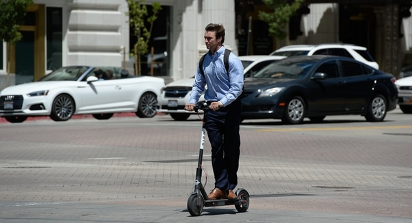 (Francisco Kjolseth   The Salt Lake Tribune) Winston Guillory, user of Bird, a dockless e-scooter company that aims to help people with the last mile of transit, scoots along South Temple on one of the recently dropped scooters in downtown Salt Lake City on Tuesday, July 3, 2018.