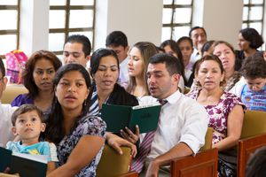 (Photo courtesy of The Church of Jesus Christ of Latter-day Saints) This file photo shows Latter-day Saints in Brazil singing during a sacrament meeting before the coronavirus pandemic.