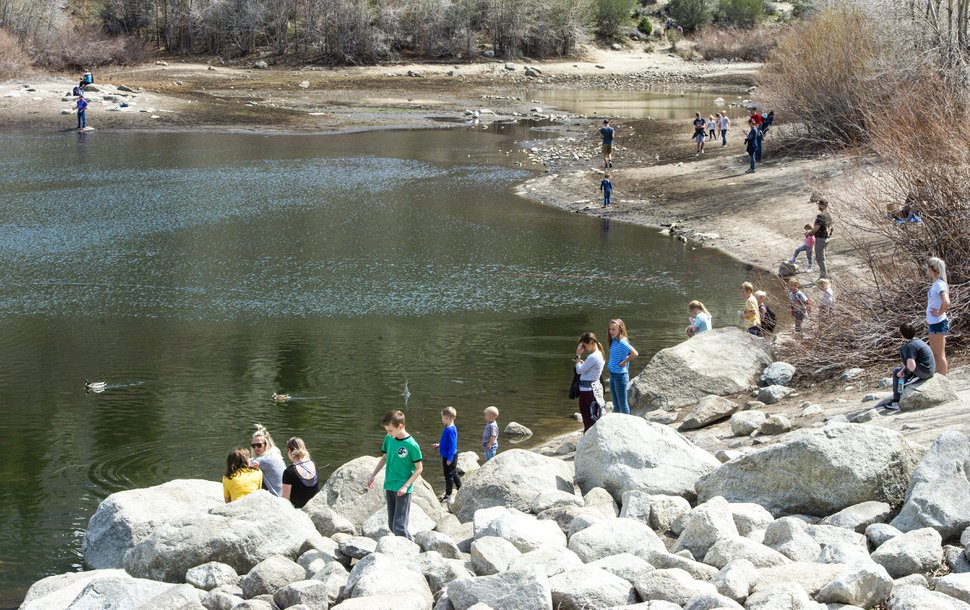 (Rick Egan   The Salt Lake Tribune) Hikers enjoy the warm afternoon sun, on the banks of the Lower Bell Canyon Reservoir, Tuesday April 7, 2020