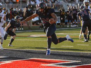 (Trent Nelson  |  The Salt Lake Tribune) Herriman's Nu'u Tafisi runs for a touchdown as Herriman hosts Davis High School football, in Herriman on Thursday, Aug. 13, 2020.
