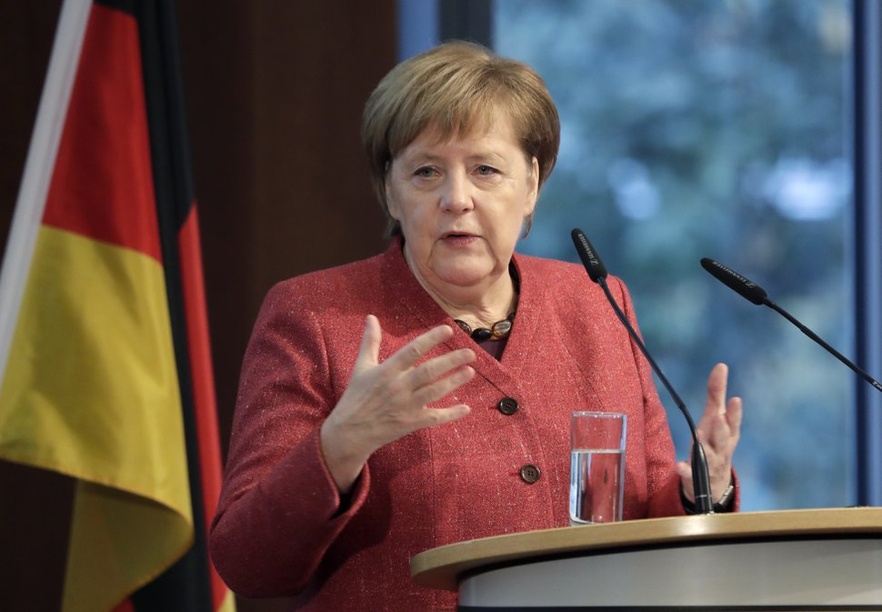 German Chancellor Angela Merkel delivers a speech during the German Ukrainian Economy Forum in Berlin, Germany, Thursday, Nov. 29, 2018. (AP Photo/Michael Sohn)