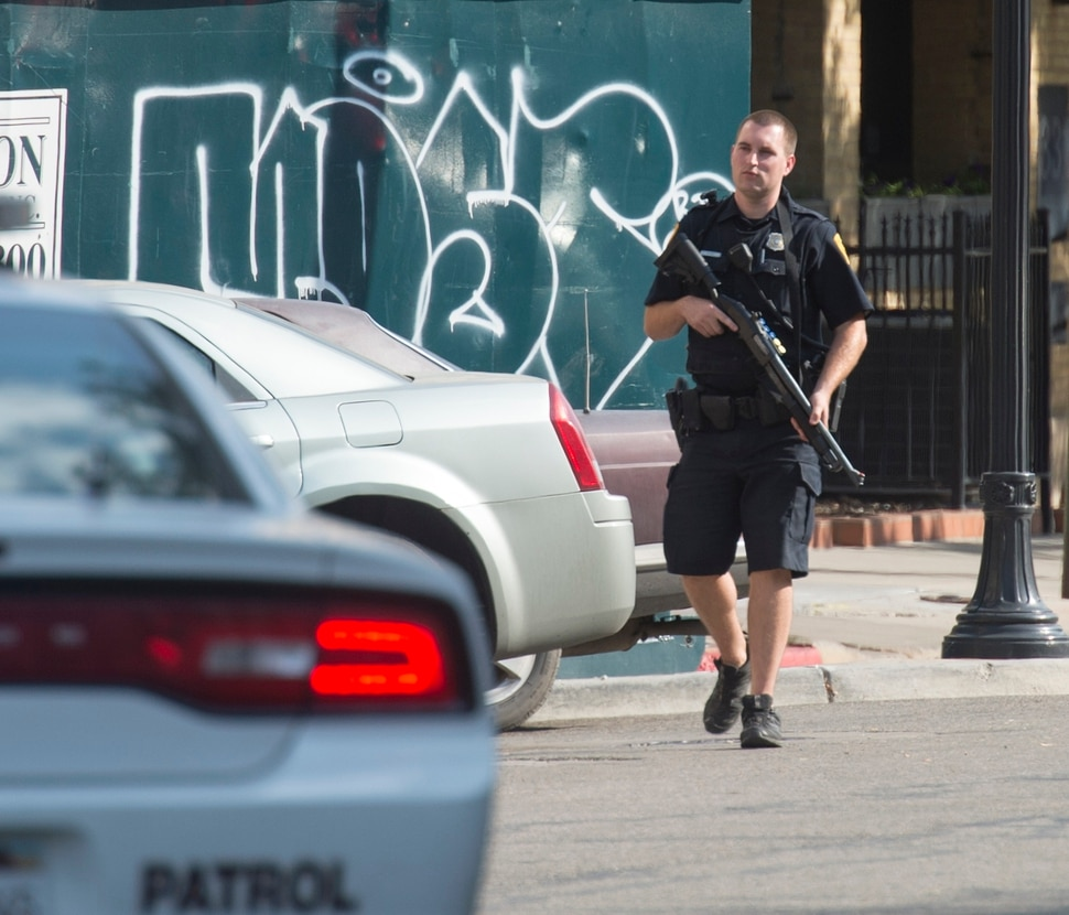 (Rick Egan | The Salt Lake Tribune) Police stand by as swat teams search buildings on Rio Grande Street for a suspect that fired shots at a police officer, Wednesday, Sept. 5, 2018.