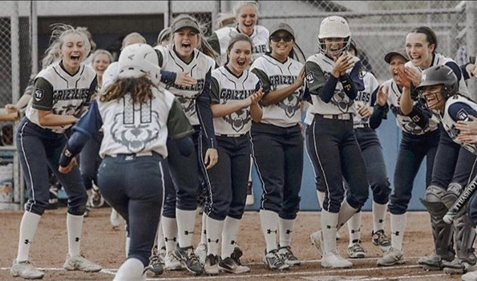 (Photo courtesy of Makaiya Gomez) Makaiya Gomez (11) meets her cheering teammates while playing for the Copper Hills High Grizzlies. Gomez, who will play for the University of Utah in the fall, won the Gatorade Utah Softball Player of the Year award.