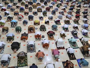 (Trisnadi | AP Photo) Indonesian Muslims pray spaced apart as they practice social distancing to curb the spread of the new coronavirus during an Eid al-Fitr prayer marking the end of the holy fasting month of Ramadan in Sidoarjo, East Java, Indonesia, Sunday, May 24, 2020.