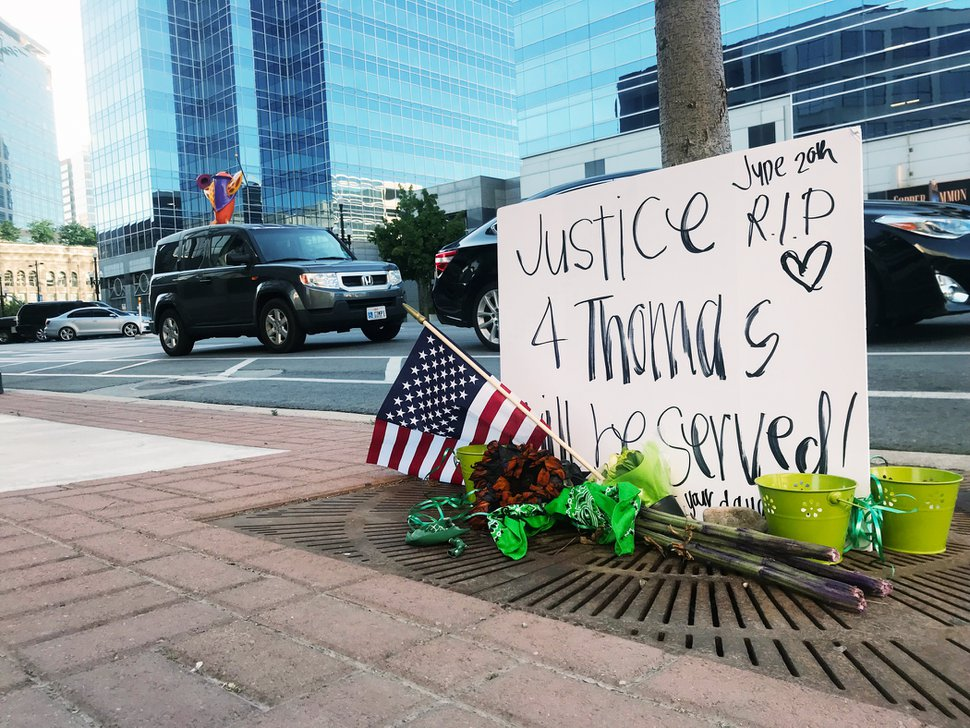 (Rachel Molenda | The Salt Lake Tribune) A memorial for Thomas Stanfield, 54, is displayed near 140 E. 300 South in Salt Lake City on Wednesday, June 20, 2018. Stanfield was shot and killed by a security guard patrolling the plaza between two government office buildings early Wednesday morning, Salt Lake City police say.