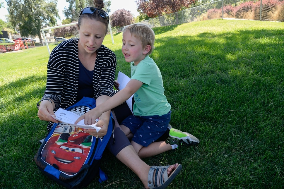 (Francisco Kjolseth | The Salt Lake Tribune) Lana Medina learns about some of the fun assignments her son Dylan, 5, had a chance to do on his first day of kindergarten at Washington Elementary on Monday, Aug. 19, 2019.