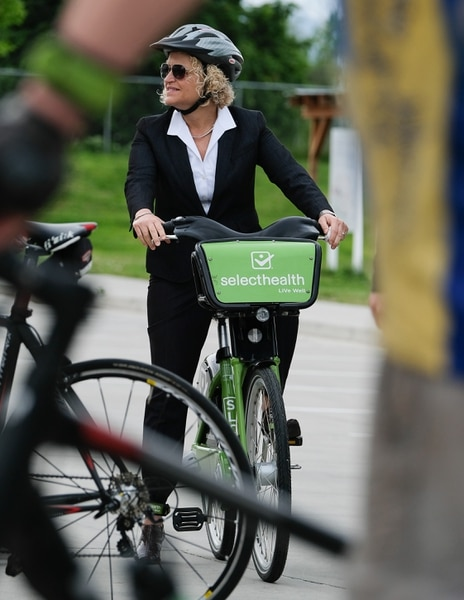 (Francisco Kjolseth   The Salt Lake Tribune) Salt Lake City Mayor Jackie Biskupski is joined by members of the public and city employees on Thursday, May 16, 2019, as part of the annual Mayor's Bike to Work Day. This year's ride began at the Northwest Recreation Center and ran primarily along the Jordan River Trail in an effort to show off the investments the city and others have made to the trail.