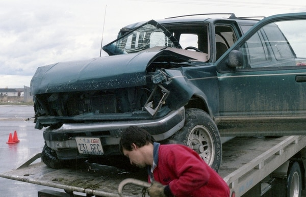 Courtesy | West Jordan Police Department A tow truck driver fastens Lyle Jeffs' Ford Explorer to the bed of a truck following a collision with another vehicle Jan. 17, 1998, in West Jordan.