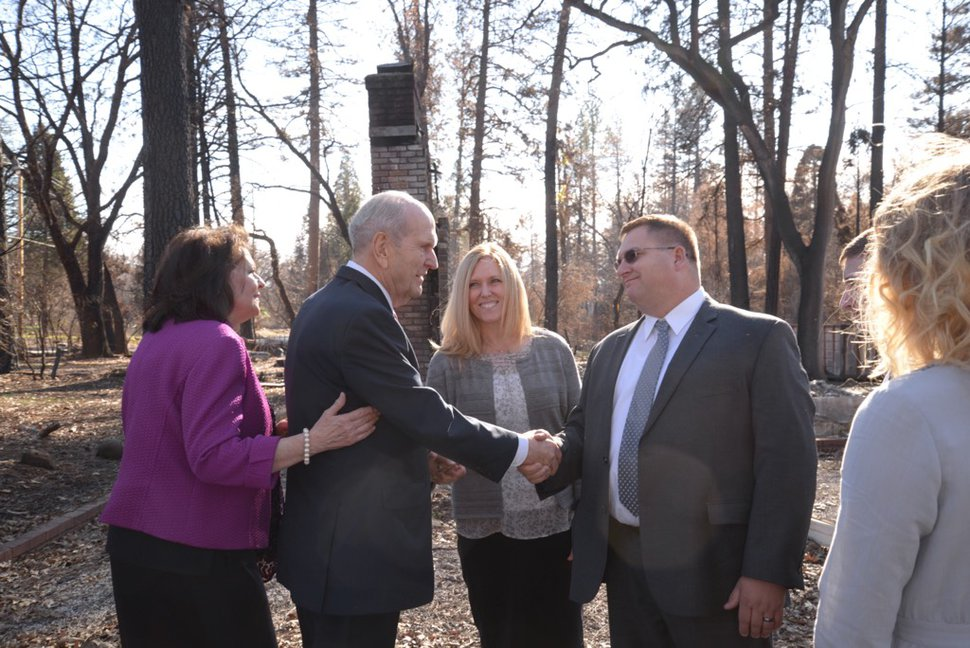 (Photo courtesy of The Church of Jesus Christ of Latter-day Saints) After his meeting in Chico, Calif., Jan. 13, 2019, President Russell M. Nelson met with Rob and Gretchen Harrison and their three children in front of what used to be their home.