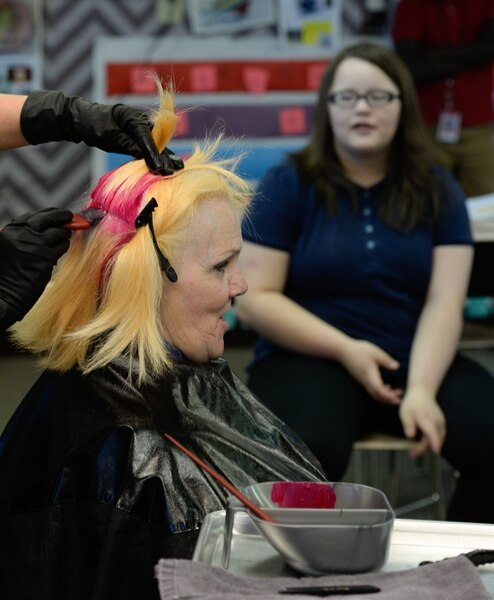 (Francisco Kjolseth | The Salt Lake Tribune) Teachers are using creative ways to get kids SAGE scores up, including Sharon Moore, 6th grade teacher at North Star Elementary who agreed to dye her hair some wild colors as she continues to teach class on Tuesday, May 8, 2018. This was the incentive that got her kids' scores up nearly 17 percent.