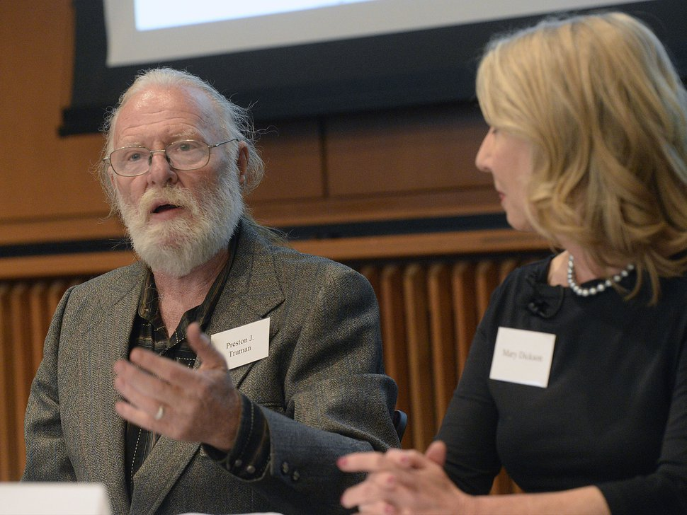 "In this Monday, Oct. 3, 2016 photo, panelist J Truman, a lifelong downwinder activist, speaks at the launch event for ""Downwinders of Utah Archive"" at the J. Willard Marriott Libray at the University of Utah, in Salt Lake City. Playwright Mary Dickson, whose 2007 play ""Exposed"" chronicled the effects the above ground nuclear tests had on the downwind population in Utah is at right. The new University of Utah archive about the state's ""downwinders"" features oral histories, photographs and newspapers clippings documenting the impact of nuclear testing during the 1950s in Nevada. (Al Hartmann /The Salt Lake Tribune via AP)"