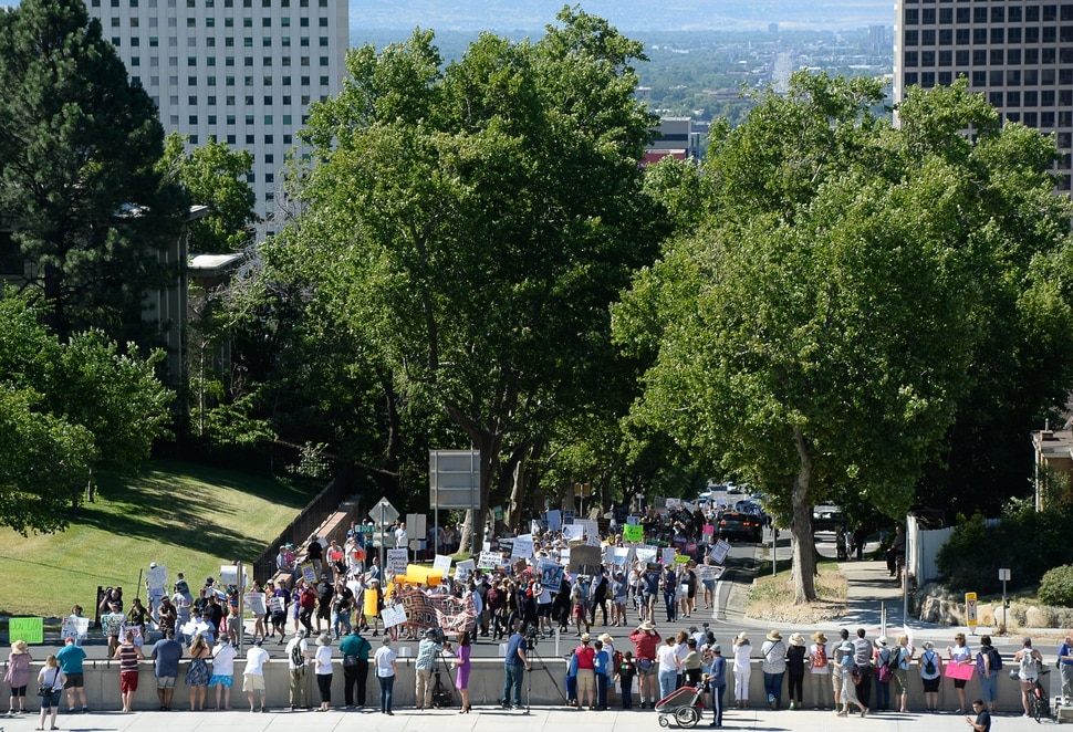 (Francisco Kjolseth | The Salt Lake Tribune) A large crowd walks up State street to the Utah Capitol on Saturday, June 30, 2018, to protest the Trump administration's immigration policies that have led to the separation of migrant families. More than 750 locations around the country planned to participate in the 'Families Belong Together' event, including at the nations capitol.