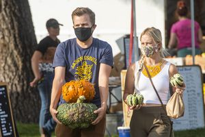 (Rick Egan  |  The Salt Lake Tribune)      Shoppers wear masks as they shop at the weekly Liberty Park Market at Liberty Park on Friday, Sept. 25, 2020.