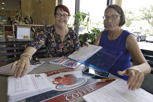 (Chris O'Meara | AP photo)  Pasco County Commission candidates Kelly Smith, left, and Brandi Geoit prepare forms for their Galentine's Day meeting Monday, Feb. 12, 2018, in Lutz, Fla. Galentine's Day, which is celebrated on Feb. 13, is a day to celebrate not only women's friendships, but activism. In the light of the #MeToo movement, Galentine's Day marks the positivity of the women's movement and female solidarity.