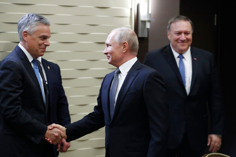 (Pavel Golovkin   AP Photo) Russian President Vladimir Putin, shakes hands with U.S. Ambassador to Russia Jon Huntsman, left, as U.S. Secretary of State Mike Pompeo, stands behind prior to their talks in the Black Sea resort city of Sochi, southern Russia, Tuesday, May 14, 2019. Pompeo arrived in Russia for talks that are expected to focus on an array of issues including arms control and Iran.