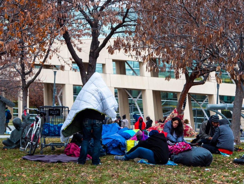 (Rick Egan   The Salt Lake Tribune) People are forced to pack up their belongings in carts and wagons near the Salt Lake City Library, Monday, Dec. 23, 2019.
