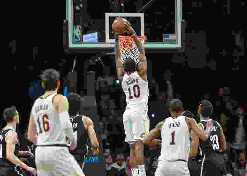 Former Jazzman Alec Burks' dunk with 3.2 seconds on clock lifts Cavaliers over Nets in his third game with Cleveland